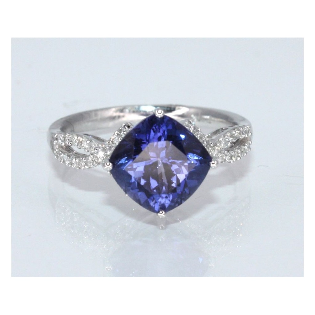TANZANITE RING WITH 3.30 CARAT TANZANITE & .23 CARAT DIAMONDS