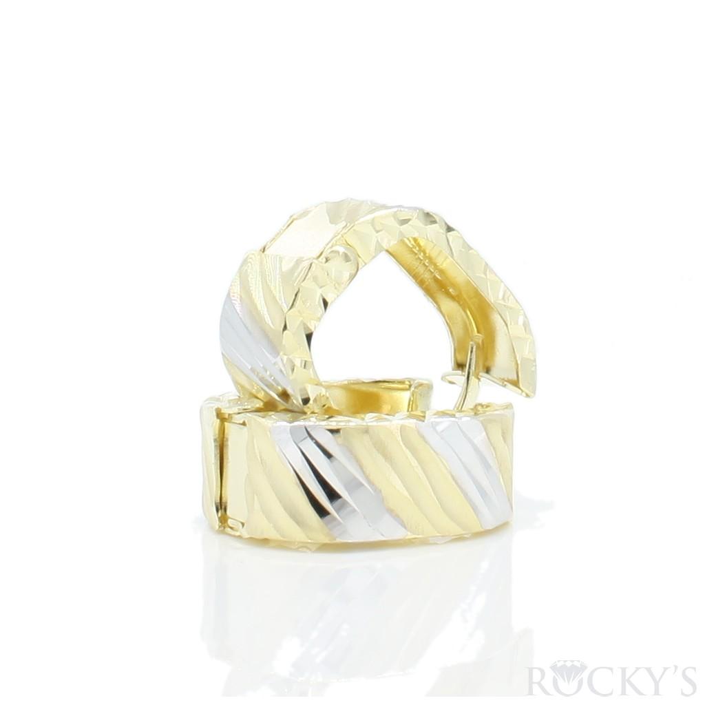Women's gold huggie earrings set in 10k yellow gold