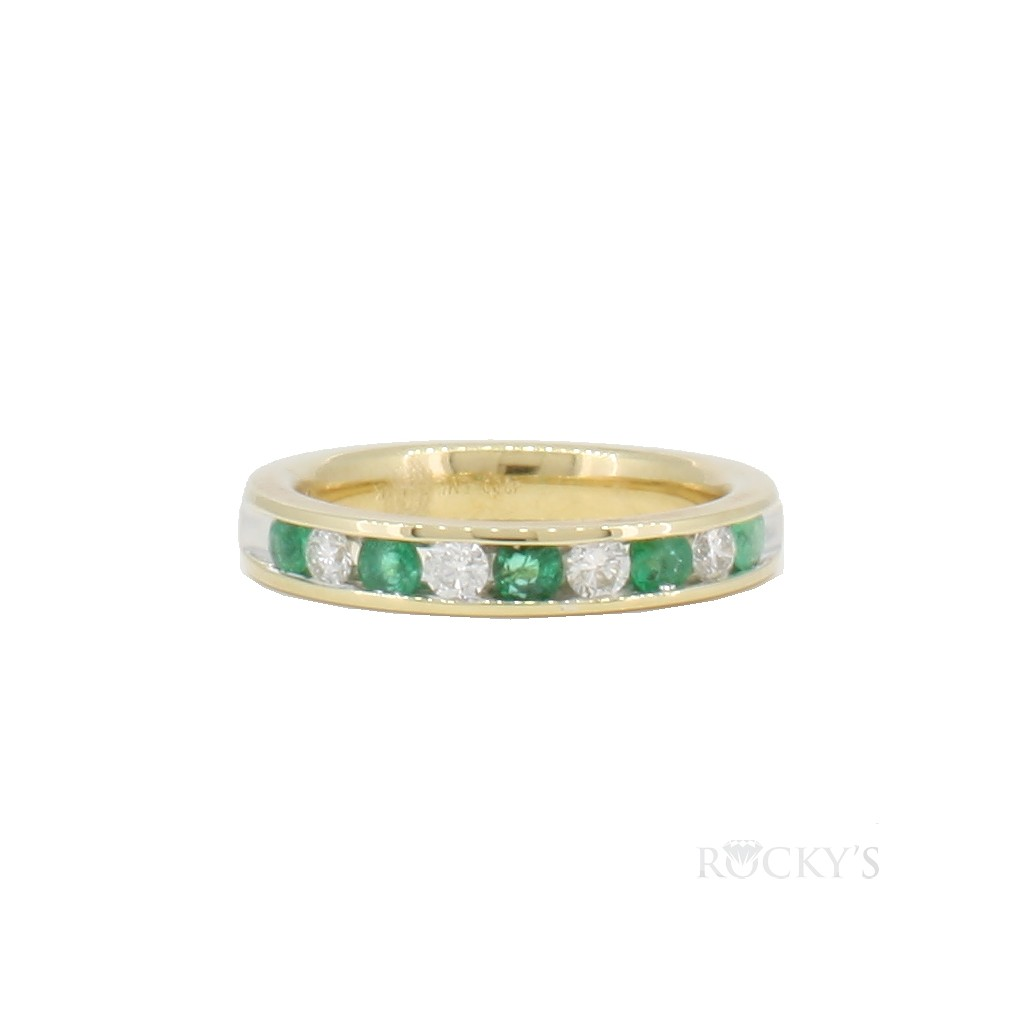 14k yellow gold emerald and diamonds band with 0.66c