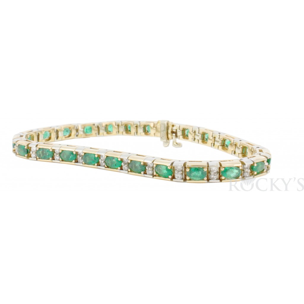 14k two tone gold emerald and diamonds bracelet with 6.29ct
